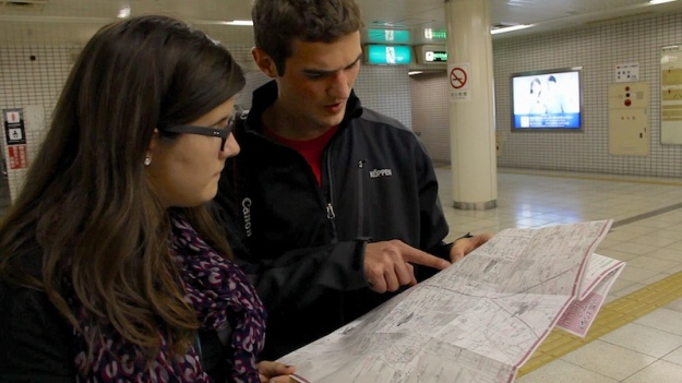 Josh and Emily looking at a map