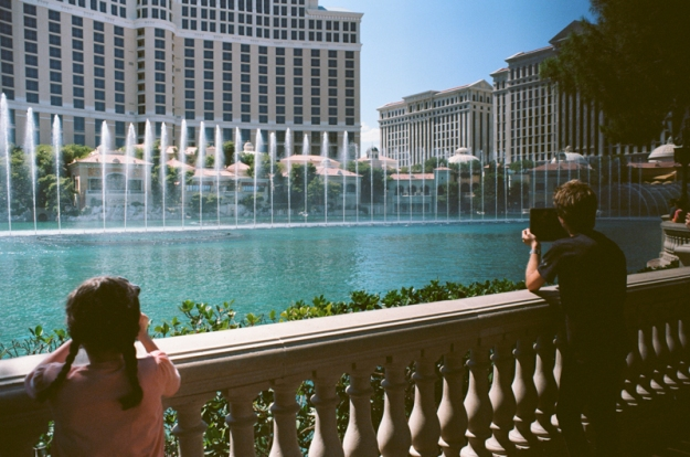 Two people recording the Bellagio Fountains - Las Vegas, Nevada