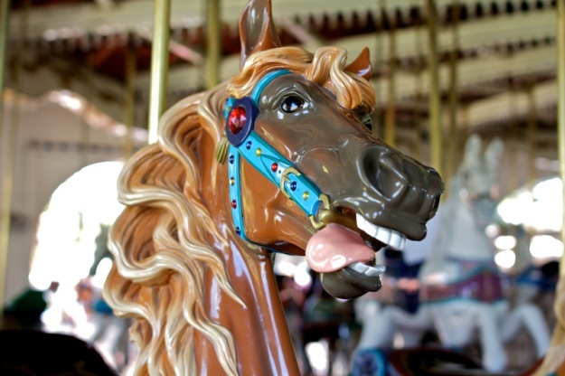 Close up of the head of a carousel horse